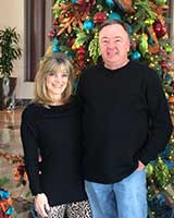 Steve with Wife and Christmas trees